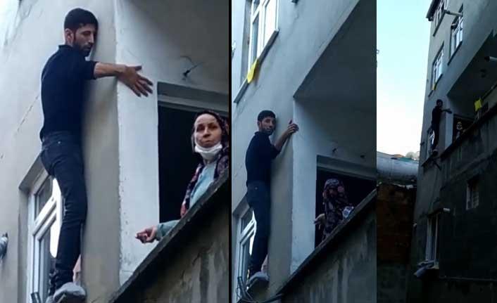 Pencerede mahsur kalan hırsız bina sakinlerine yalvardı