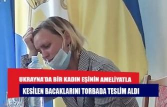 Ukrayna'da bir kadın eşinin ameliyatla kesilen bacaklarını torbada teslim aldı