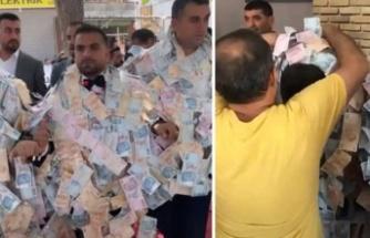 Düğününde damada takılan parayı 4 kişi zor taşıdı